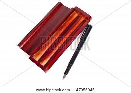 fountain pen in wooden case made of mahogany on the isolated background, business concept