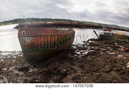 A wreckage of an abandoned ship anchored in Bowling. Scotland