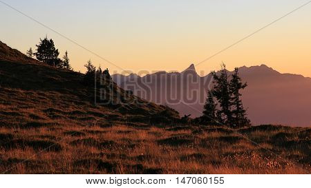 Summer evening on Mt Niederhorn Swiss Alps. Silhouette of Mt Stockhorn.