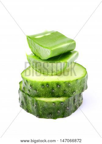 Fresh leaves of aloe Vera and two slices of cucumber.