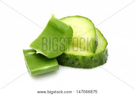 Fresh leaves of aloe Vera and slices of cucumber.Isolated on white background.