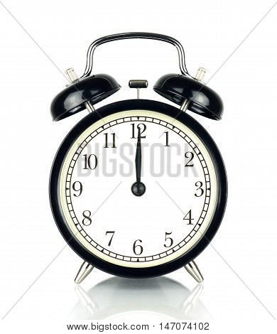 Alarm Clock isolated on white in black and white showing twelve o'clock.
