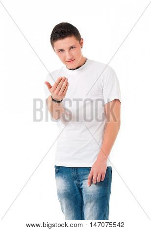 Serious suspicious young man standing with hands in pockets, isolated white background. Full length portrait of anger teen boy threatening.  poster