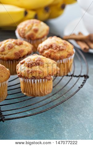 Banana muffins with cinnamon and streusel on cooling rack