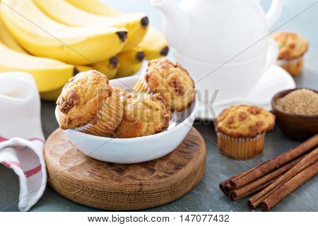 Banana muffins with cinnamon and streusel on breakfast table