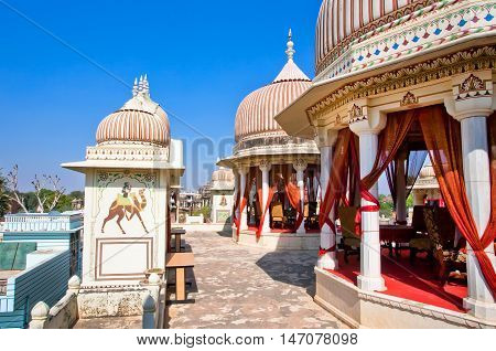 MANDAWA, INDIA - FEB 7, 2015: Retro style restaurant in a historical palace with towers on February 7, 2015. With population of 21000 Mandawa is a touristic site with artistic Havelis mansions