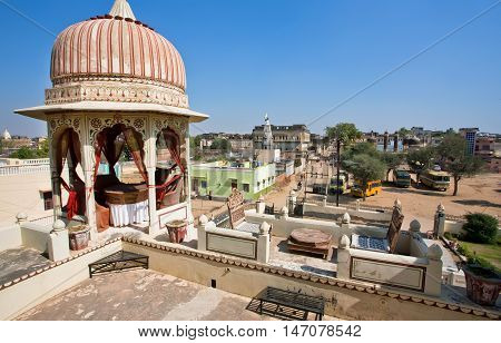 MANDAWA, INDIA - FEB 7, 2015: Tower of ancient palace and city view on the background on February 7, 2015. With population of 21000 Mandawa is a touristic site with artistic Havelis mansions