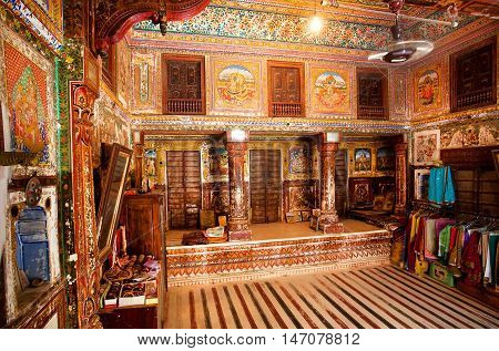 MANDAWA, INDIA - FEB 7, 2015: Interior of room with old frescoes in ancient Haveli house on February 7, 2015 in Shekhawati. With population of 21000 Mandawa is popular site with naive art Havelis homes