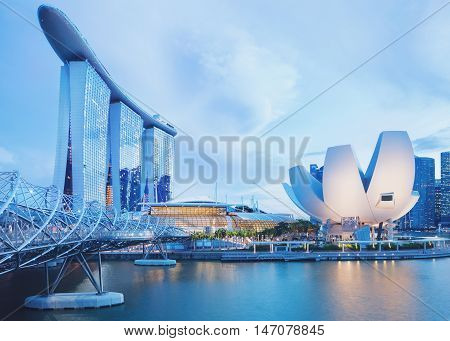 Singapore, Republic of Singapore - May 3, 2016: Panorama of Marina Bay with Marina Bay Sands hotel and Artscience lotus flower museum glowing at night