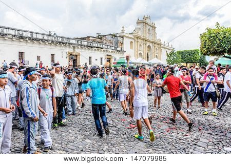 Antigua Guatemala - September 14 2015: Locals run with lit torches in front of cathedral during Guatemalan Independence Day celebrations