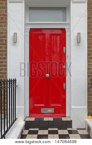 Red Entrance Door With Doorknob and Transom Window