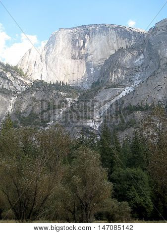 General view of the Half-Dome from the valley bottom in Yosemite National Park (California, USA)