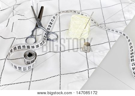 Sewing supplies - scissors, needle, thread, thimble and measuring tape