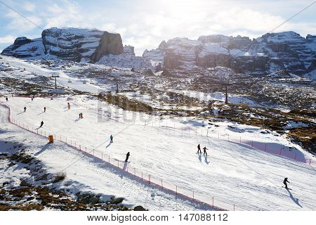 MADONNA DI CAMPIGLIO ITALY - DECEMBER 18: The ski and skiers at Passo Groste ski area on December 18 2015 in Madonna di Campiglio Italy. More then 46 mln tourists is expected to visit Italy in year 2015.