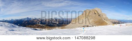 The panorama of ski and skiers at Passo Groste ski area Madonna di Campiglio Italy