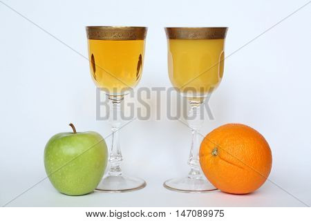 apple and orange  beneficial fruits and juices on a white background