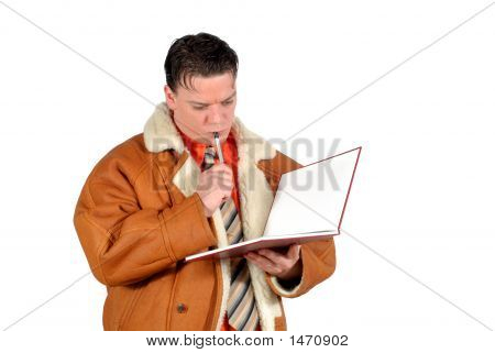 Young Pensive Businessman Making Notes