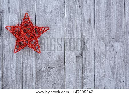 A Handmade Christmas star on wooden background.