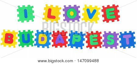 Message I Love Budapest from letters puzzle isolated on white background.