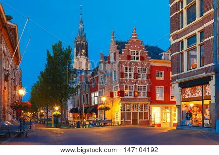 Night canal, typical dutch house and Gothic Protestant Nieuwe Kerk, New church, in Delft, Holland, Netherlands
