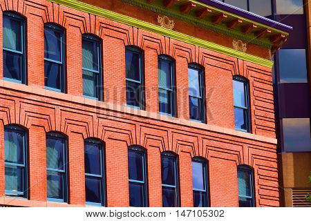 Old historic refurbished brick office building taken in Downtown Denver, CO