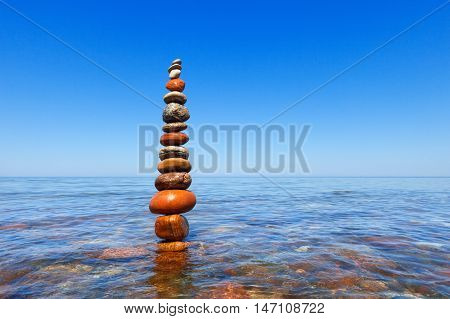 Concept of harmony and balance. Rock Zen in water. Balance and poise stones against the sea