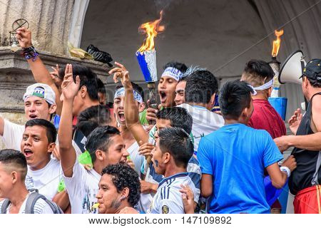 Antigua Guatemala - September 14 2015: Locals cheer with lit torches outside city hall during Guatemalan Independence Day celebrations