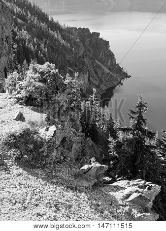 A series of jagged cliffs make up the walls of Crater Lake in Oregon.