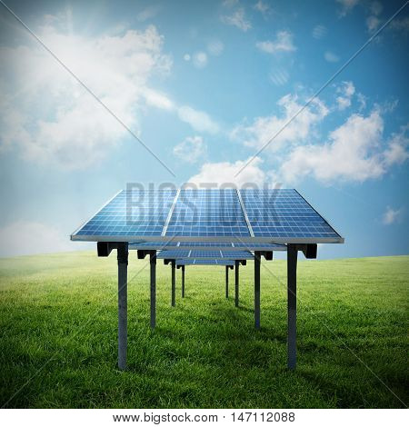 Solar panel in a field with the sky and the sun