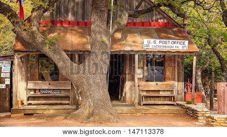 LUCKENBACH, TEXAS - APRIL 7: A building serving as the post office, store and bar in Luckenbach, Texas on April 7th, 2016.