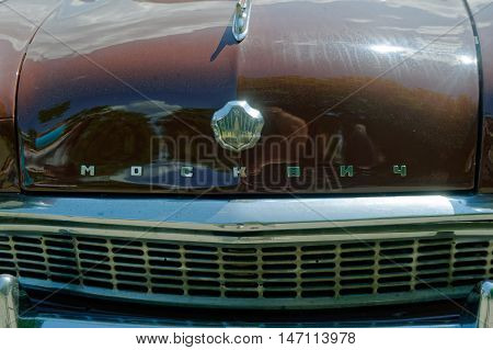 Kharkiv Ukraine - May 22 2016: Close up of Soviet retro car brown Moskvich 407 manufactured in 1961 exhibited at the festival of vintage cars Kharkiv Retro Rally - 2016 in Kharkiv Ukraine on May 22 2016
