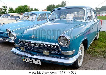 Kharkiv Ukraine - May 22 2016: Soviet retro car blue sedan GAZ M21 Volga Third Series manufactured in 1962 is presented at the festival of vintage cars Kharkiv Retro Rally - 2016 in Kharkiv Ukraine on May 22 2016