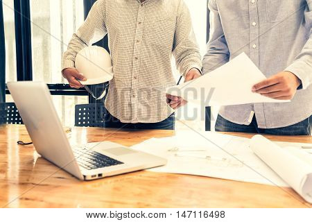 engineer people meeting working in office for discussing engineering concept architecture concept soft focus vintage tone