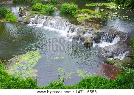 Mini waterfall in the city park or garden in restaurant. Natural scene. Beauty in nature