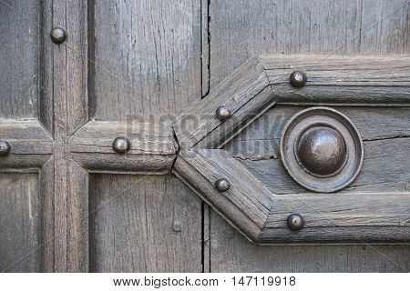 Fragment of an old wooden door of Saint Sernin Basilica in Toulouse, France. poster