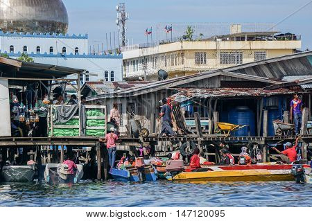 Semporna,Sabah-Sep 10,2016:Daily life of Semporna bajau water village at Semporna,Sabah on 10th Sept 2016.The water village is a popular tourist attraction area in Semporna,Sabah.