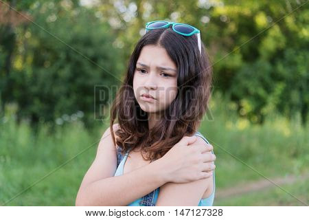 teen girl with health problems in the nature in summer