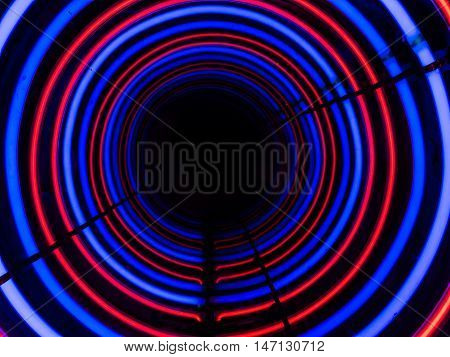 Tunnel of red and blue circles into the abyss