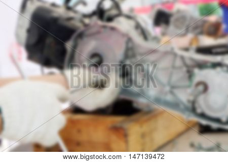 Blur image hands of disassembly kit motorcycle in repair service.