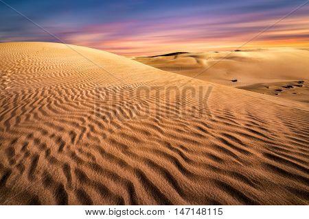 Stunning sunset over a sand dune