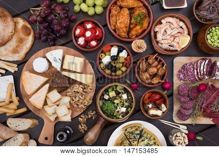 top view tapas food hero header on wooden backgrouns