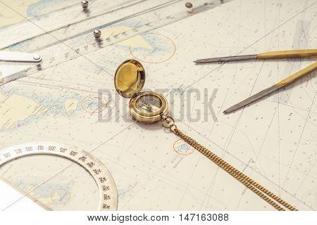 Navigation still-life. Skipper equipment, compass, ruler, protractor and a map. Sailing concept.