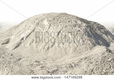 sunny illuminated light brown heap of earth in gradient white back