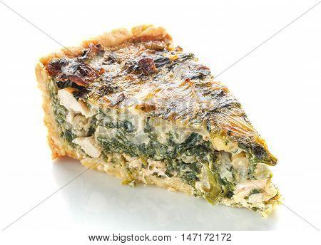 piece spinach quiche pie isolated on white background