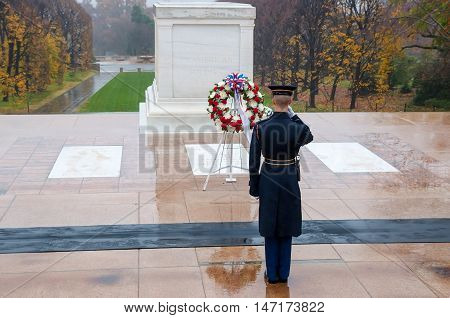 Arlington USA - November 16 2011: Soldier salutes - changing the guard in the afternoon at the grave of the unknown soldier at the cemetery of Arlington in Washington USA