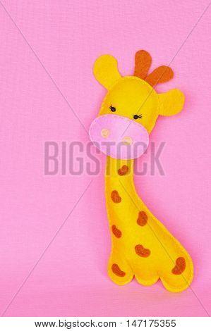 Cute yellow giraffe sewn from felt. Soft kids toy. Stuffed giraffe toy. Sewing crafts