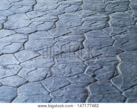 floor made of stone tiles painted in bluish grey