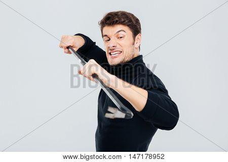 Portrait of man criminal burglar using crowbar