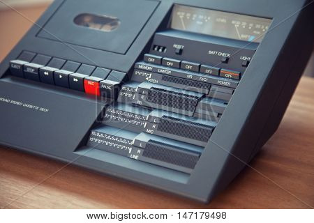 Vintage stereo compact cassette tape deck player closeup