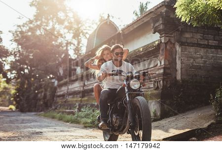 Man Riding On A Fast Motorcycle With Girlfriend